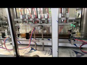 स्वचालित इंजन तेल भरने की मशीन